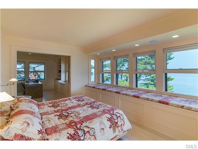 Wake up to stunning water views in the Master Bedroom Suite-